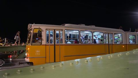 Yellow tram on Liberty Bridge in Budapest Footage