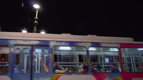 Blue tram on Liberty Bridge in Budapest Live Action
