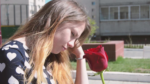 A beautiful girl visits the rose Footage