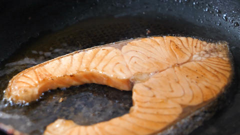 Close-up shot cooking and grill salmon steak in the hot pan the food for good health Footage