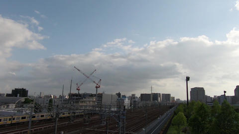 Japan city scenery. Commuter train in the evening ライブ動画