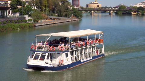 Seville, Spain - May 20, 2019: Tourist enjoying a river cruise at Guadalquivir Footage