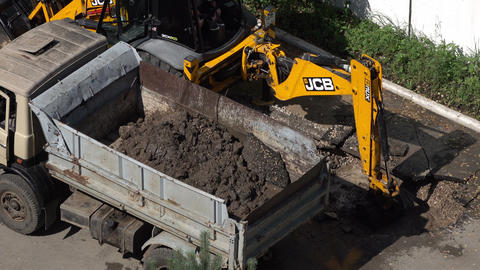 excavator digging a hole Footage