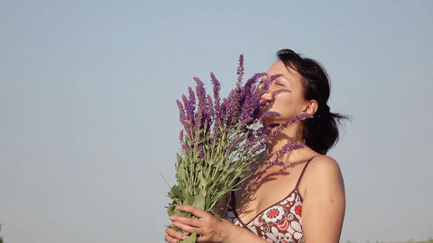 woman smelling a bouquet of wildflowers Live Action