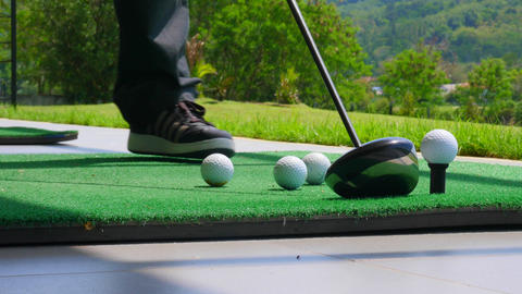 Golf ball behind driver at driving range Footage