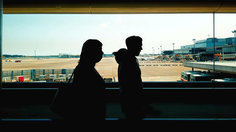 Silhouette tourists walking in Narita international airport, business travel concept Footage