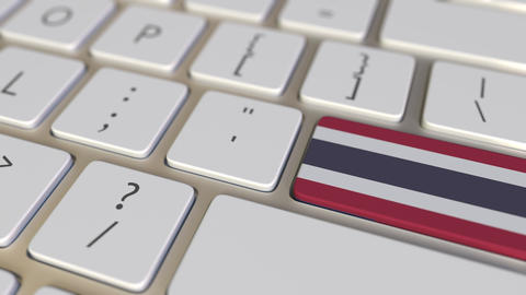 Key with flag of Thailand on the computer keyboard switches to key with flag of Footage