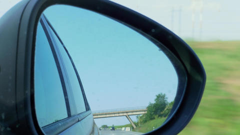 Car reflection in right side rear view mirror during driving Live Action