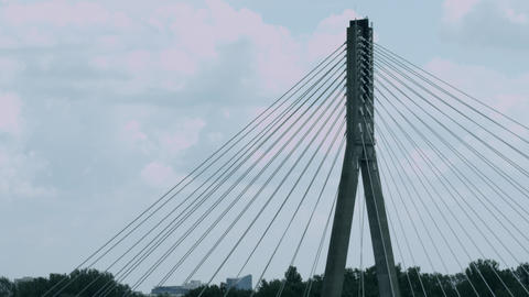 Top of cable-stayed bridge against curling clouds time lapse Footage