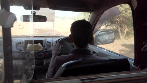 Safari Jeeps Drive on Rough Dirt Road - View of Driver Live Action