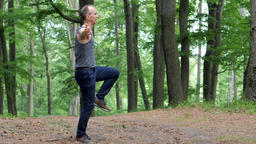Man performs simple exercises surrounded by nature and fresh air Live Action