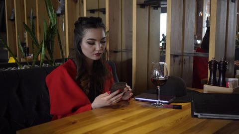 4K Pretty Woman Drinking Red Wine And Texting Sms On Smartphone Live Action