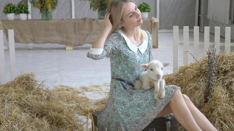 Happy Young Girl Caressing Happy Cute Kid Goat Footage