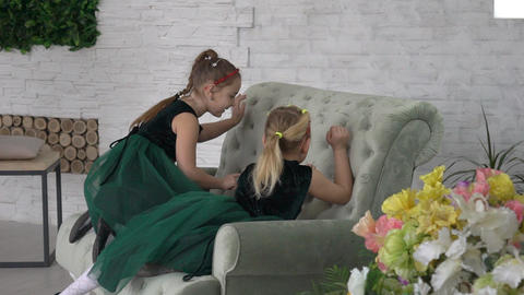 Two Sisters Playing On Sofa In Living Room Footage
