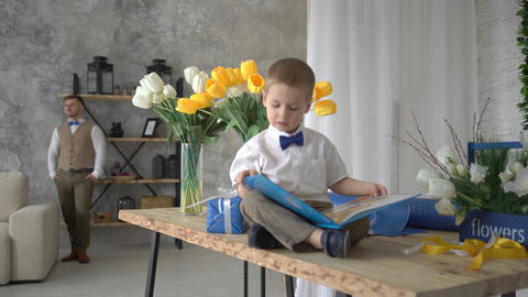 4K Little Boy Reading An Illustrated Book Footage