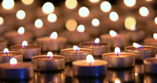 Many candles burning with shallow depth of field Footage
