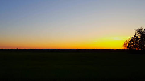 Beautiful Rural Countryside Landscape at Sunset With Camera Panning. Scenic Country Scene at Dusk Footage