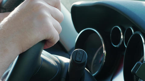 Hand on steering wheel, changer, car dashboard, automobile Live Action