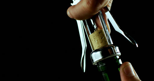 Close-up of hand opening the wine bottle 4k Live Action