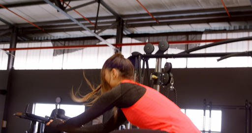 Determined beautiful Caucasian woman doing jump squat in fitness studio 4k Live Action