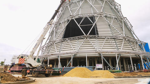 new cooling tower building with workers and crane timelapse Footage
