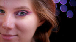 Closeup shoot of young attractive caucasian female face with half applied Footage