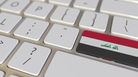 Key with flag of Iraq on the computer keyboard switches to key with flag of Footage