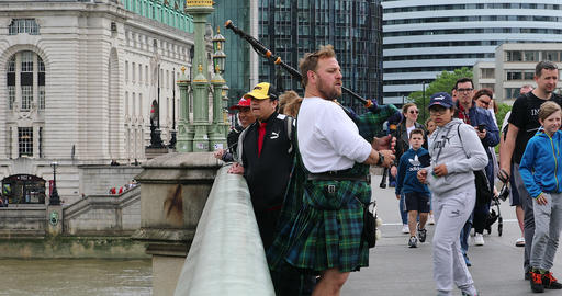 Scottish Bagpiper Playing On A Bridge In London Footage