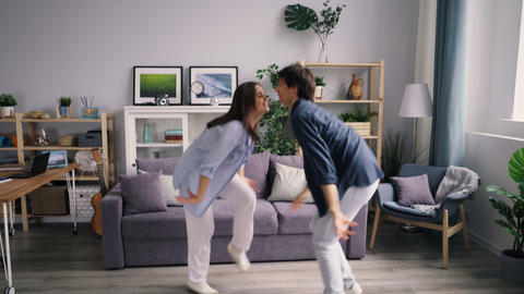 Girl and guy happy youth dancing at home relaxing and... Stock Video Footage