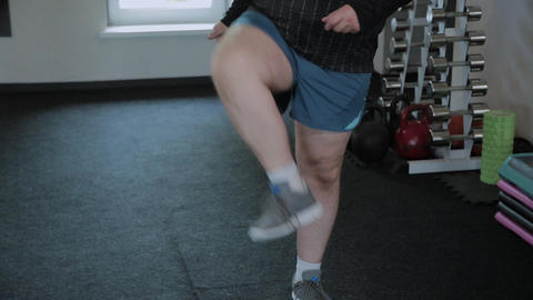Overweight adult man warming up in the gym Footage