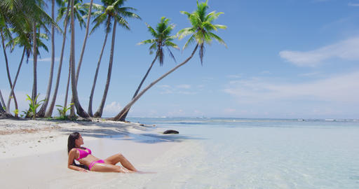 Travel Beach vacation paradise suntan woman relaxing lying sun tanning in summer Footage