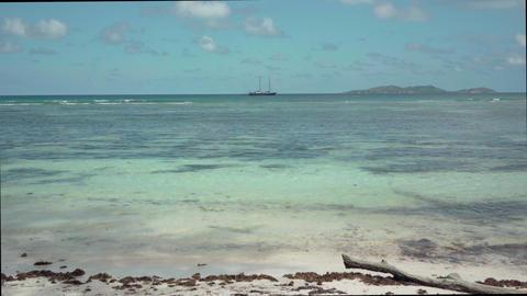 Seychelles. Praslin Island. Ship far away in the ocean. Iceland is far away on Live Action