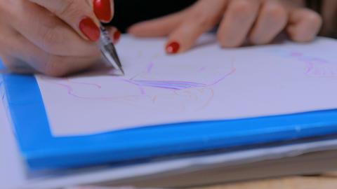 Fashion designer drawing design sketch Footage