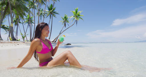 Beach vacation paradise suntan woman relaxing drinking cocktail drink Footage