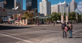 Panning Time lapse Of Busy Downtown Intersection In Daytime Footage