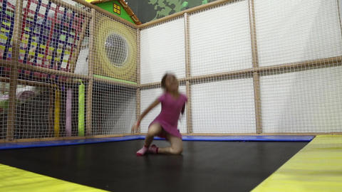 A girl jumping on a trampoline Live Action
