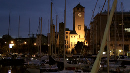 Europe Italy Liguria Savona 048 sailing boats in harbor and church tower by nigh Footage