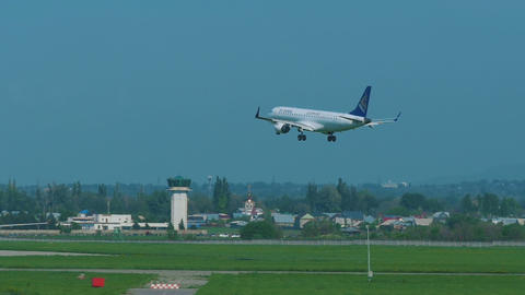 Air Astana Embraer 190 approaching and landing Footage