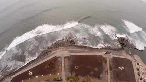 Aerial view of the beach and the waves. Slow action Footage
