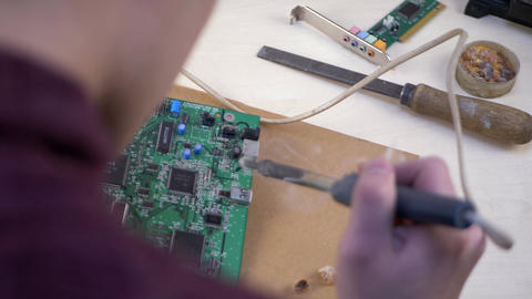 Student Soldering Electronic Components Live Action