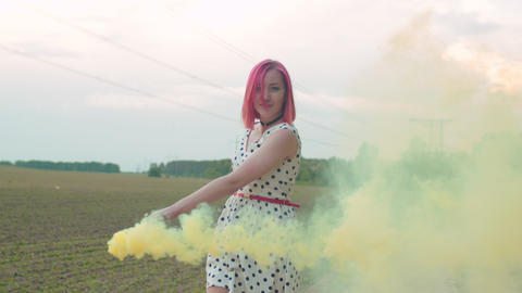 Carefree woman walking in clouds of smoke outdoors Live Action