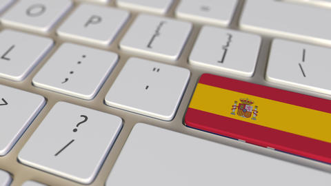 Key with flag of Spain on the computer keyboard switches to key with flag of Live Action