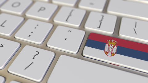 Key with flag of Serbia on the computer keyboard switches to key with flag of Live Action