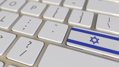 Key with flag of Israel on the computer keyboard switches to key with flag of Footage