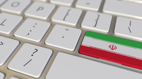 Key with flag of Iran on the computer keyboard switches to key with flag of Live Action