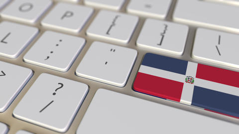 Key with flag of the Dominican Republic on the computer keyboard switches to key Footage