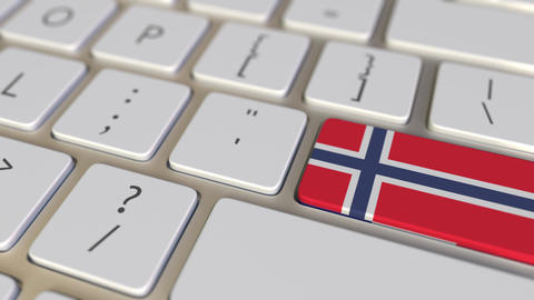 Key with flag of Norway on the computer keyboard switches to key with flag of Footage