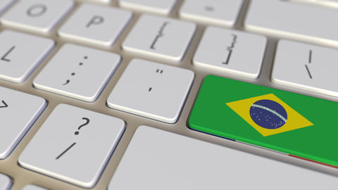Key with flag of Brazil on the computer keyboard switches to key with flag of Live Action