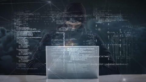 Hacker in ski mask typing on laptop while looking around nervously Animation