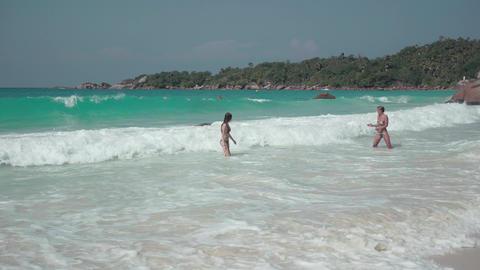 Seychelles. Praslin Island. Two cute girls resting on an exotic island in the Footage